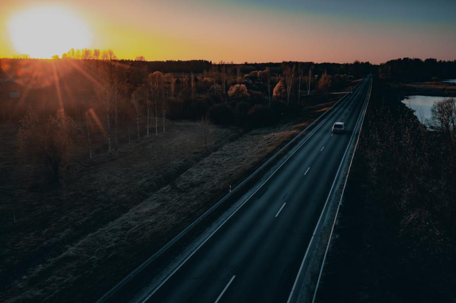 motorway at sunset .