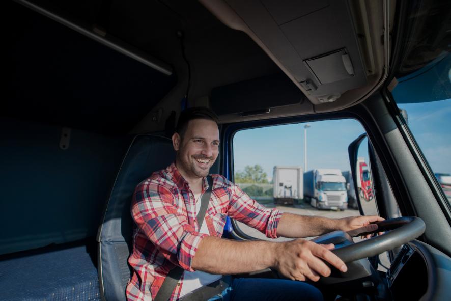 Smiling trucker enjoying his job