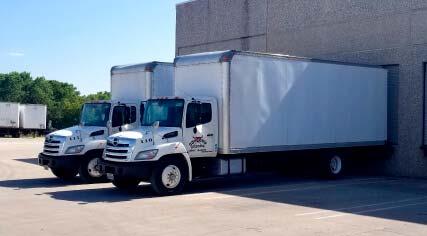 two straight trucks
