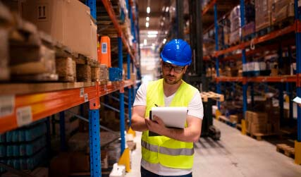 Warehouse worker writing down report