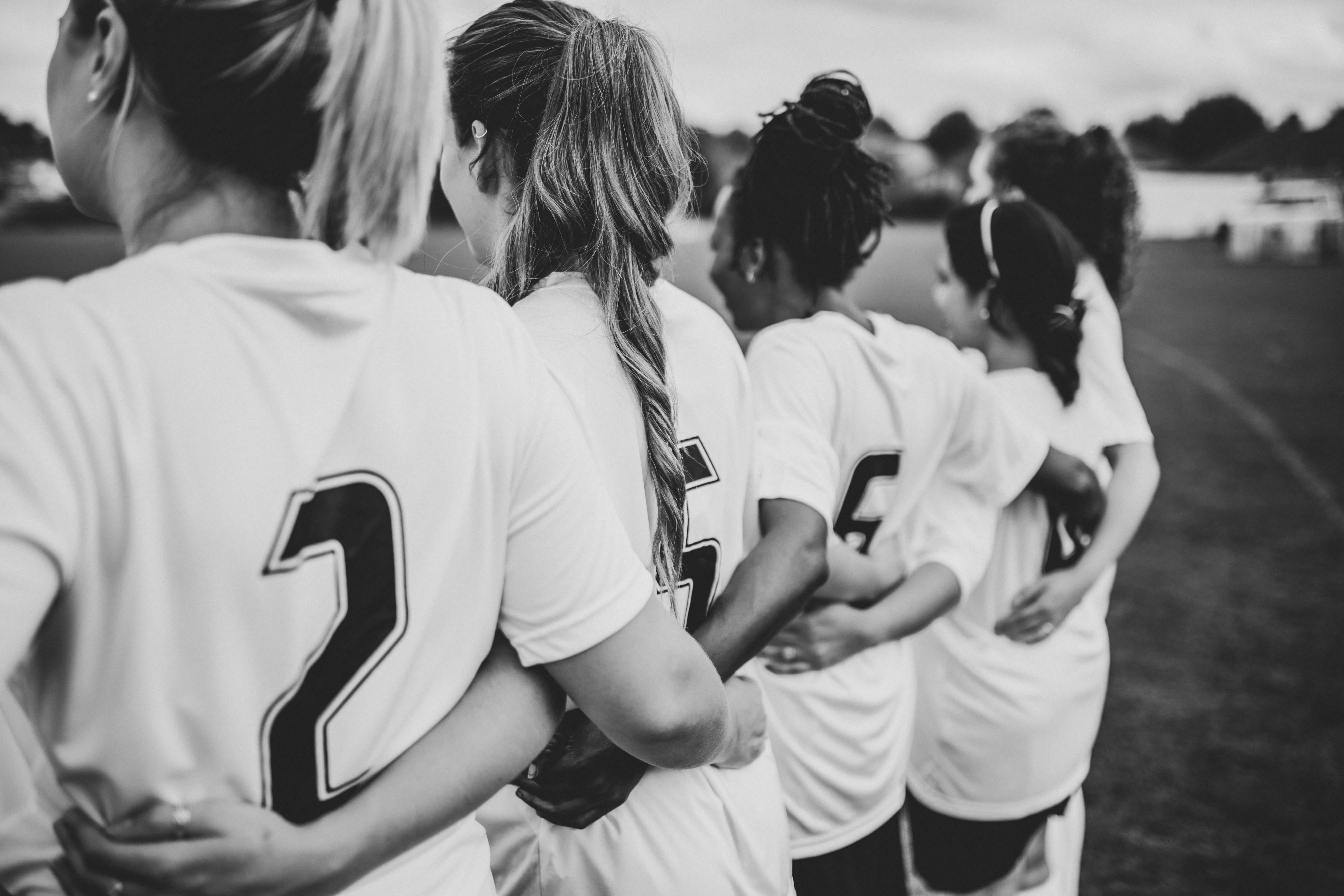 Black and white photo of a female football team
