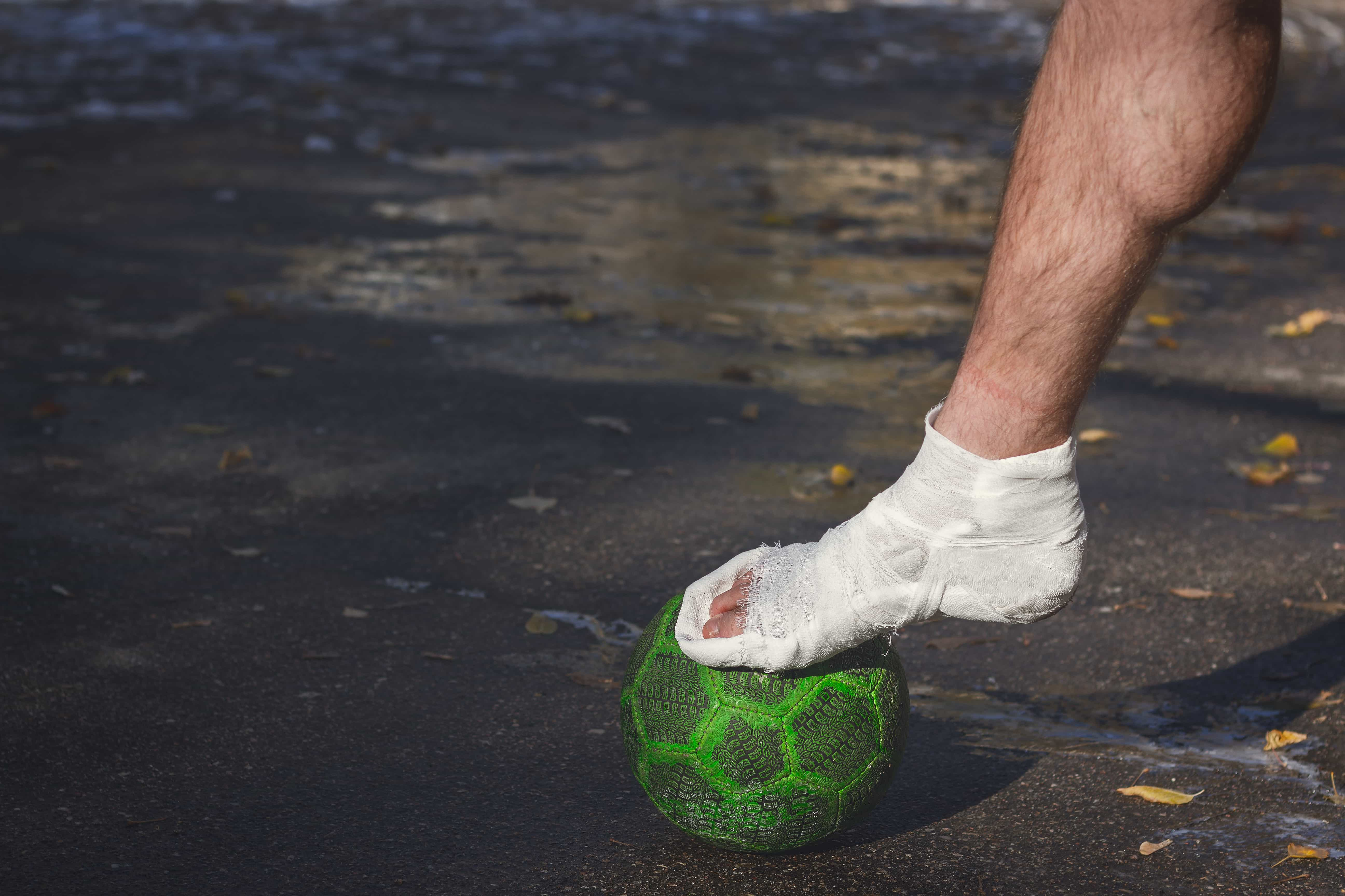Injured player with a primitive football