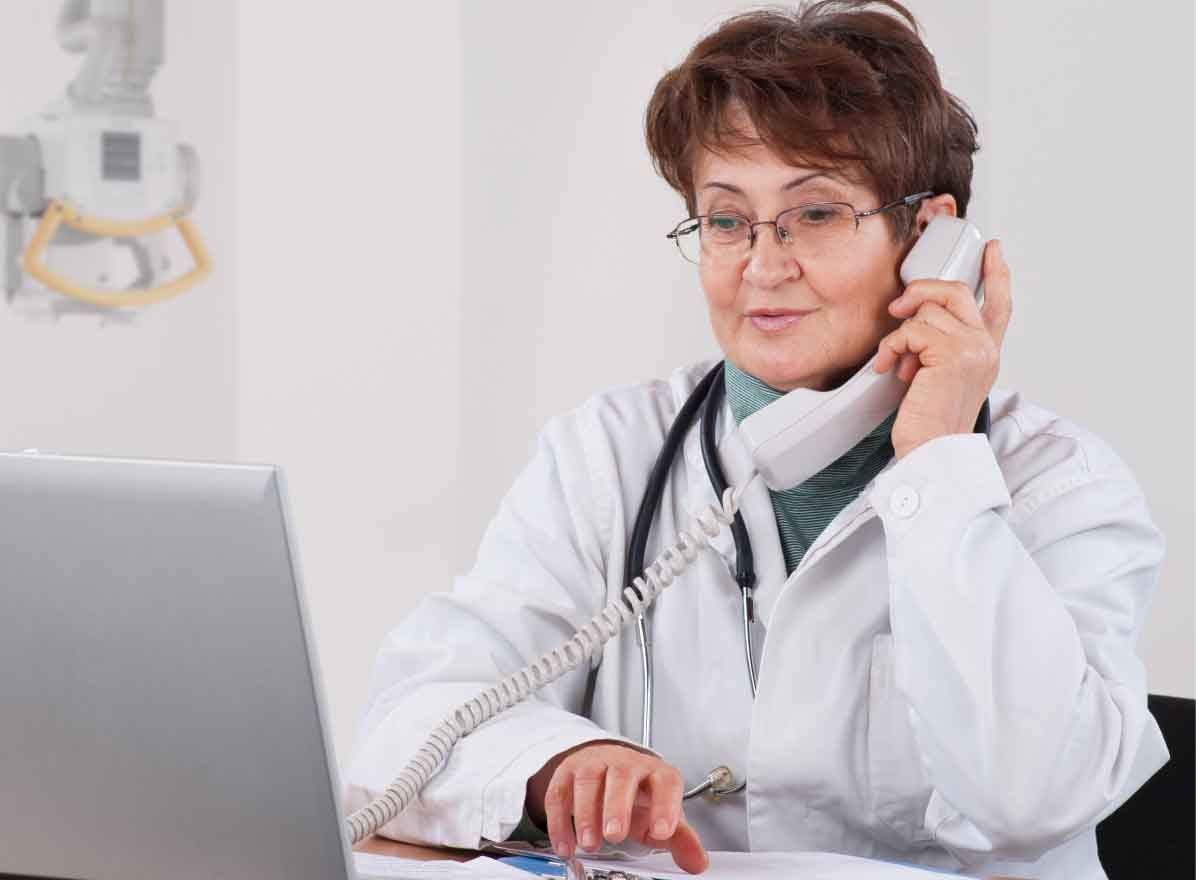 Occupational medicine clinician providing guidance over the phone