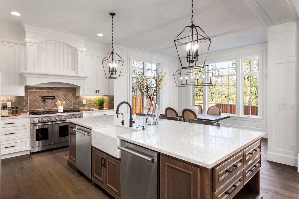 A fancy home kitchen with large island.