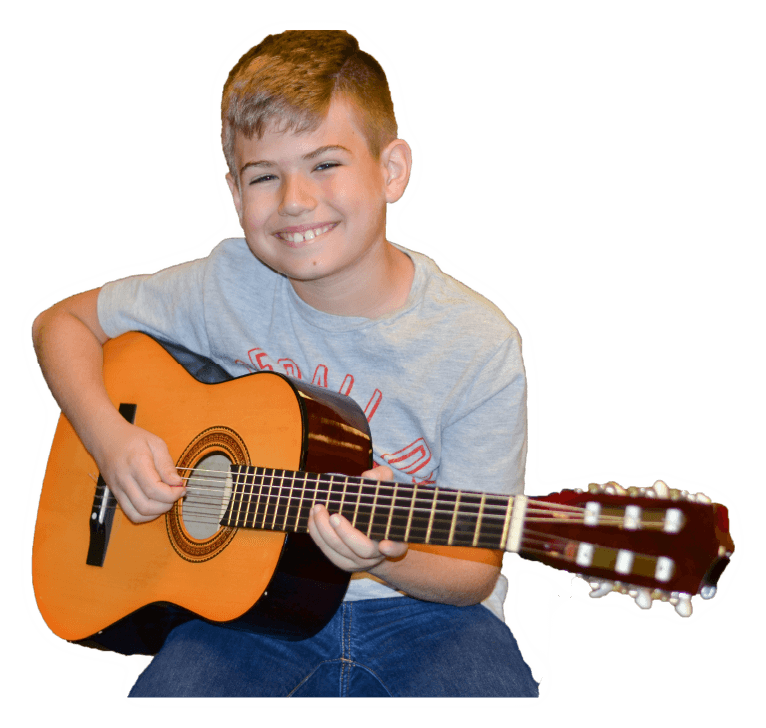 Boy learning guitar in group lessons after-school or online
