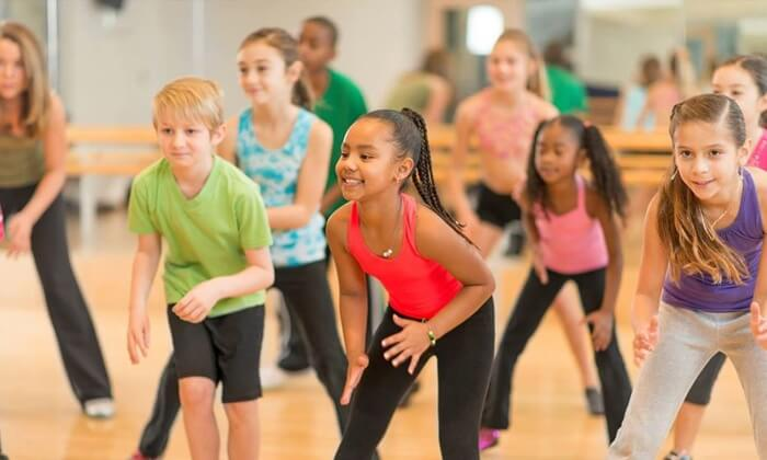 Students learning hip-hop dance in after-school or online classes