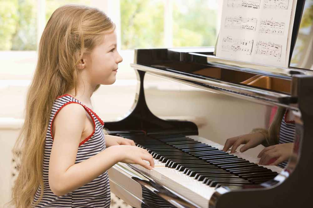 young girl piano student practicing scales
