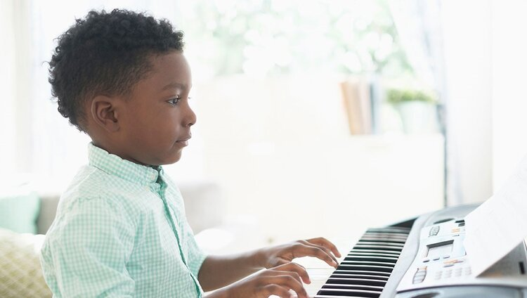 young boy piano student in private music lessons