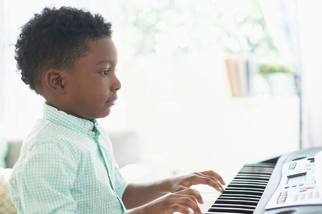 young piano student practicing