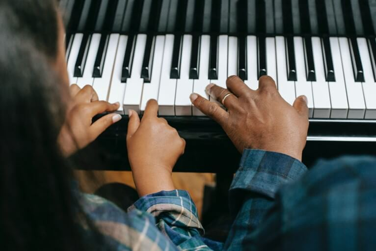 young beginner piano student learning major and minor chords