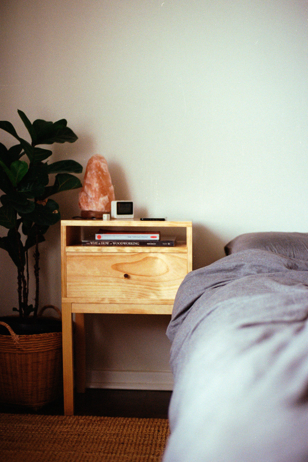 Solid pine nedside table in bedroom