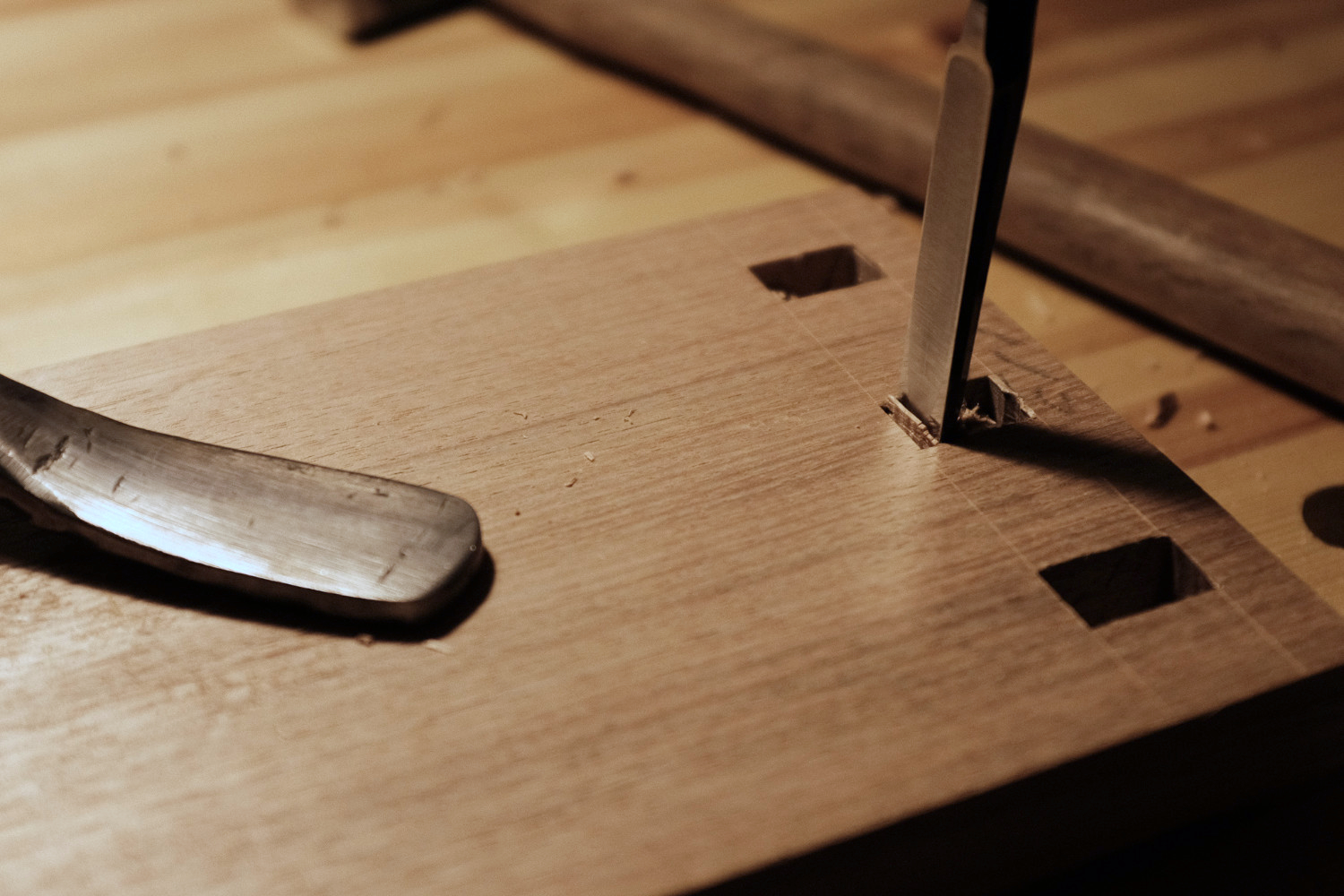 Hand chiseling out mortise