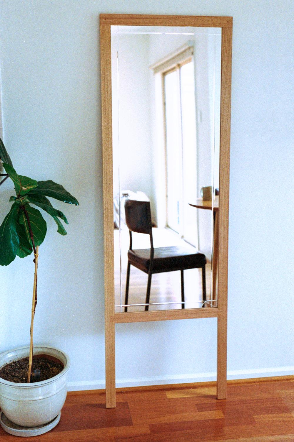 Oak framed freestanding leaning mirror