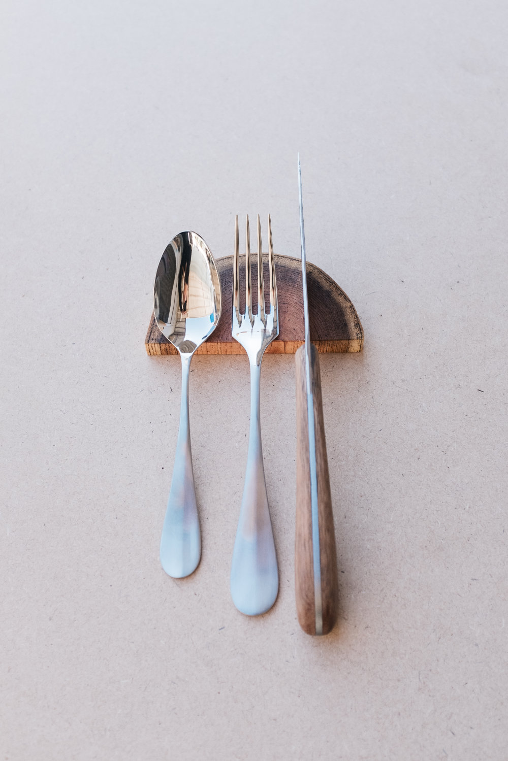 Cutlery rests with cutlery placed on
