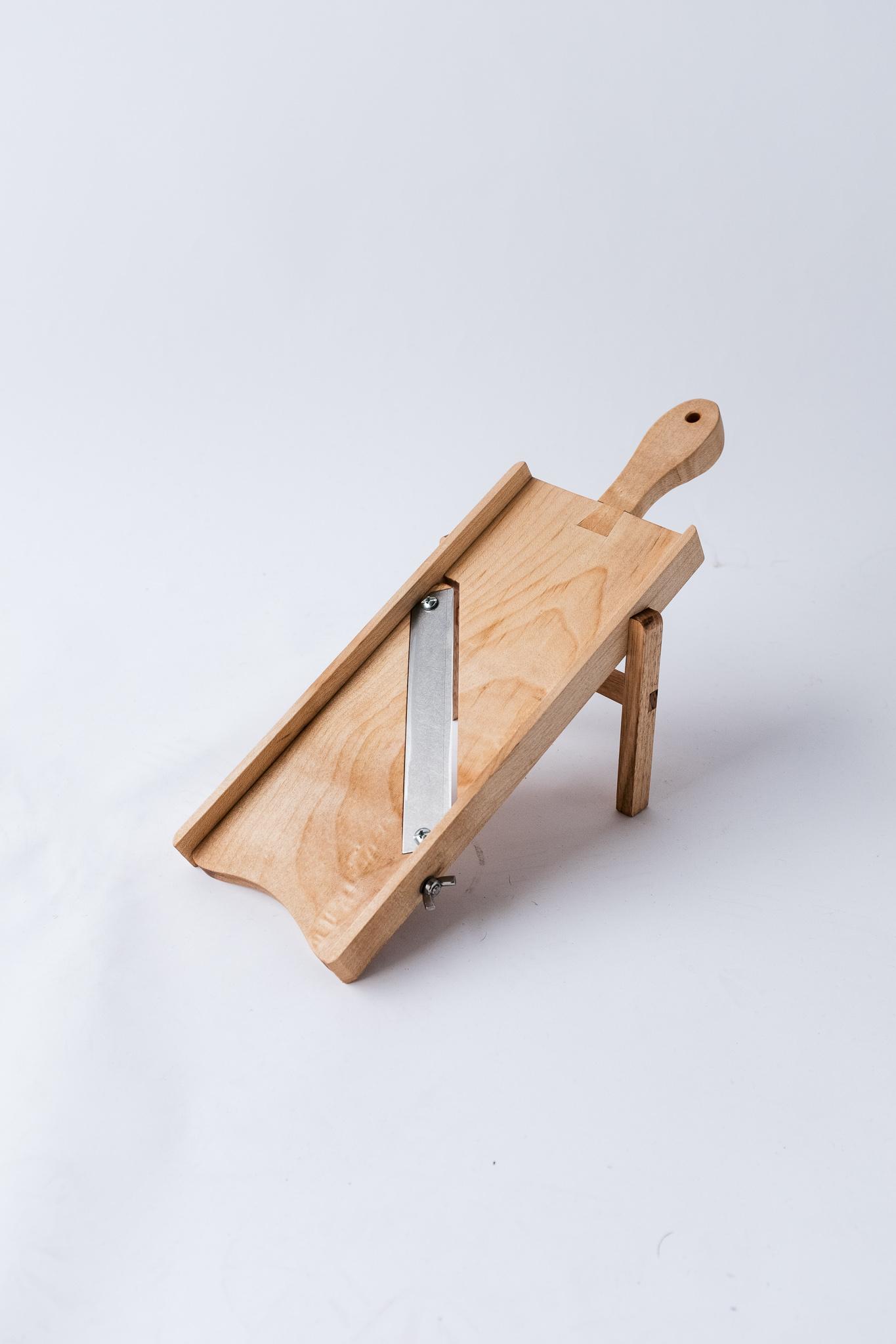 Wooden mandoline on stand
