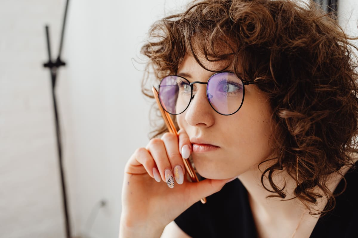 A woman thinking about what to do