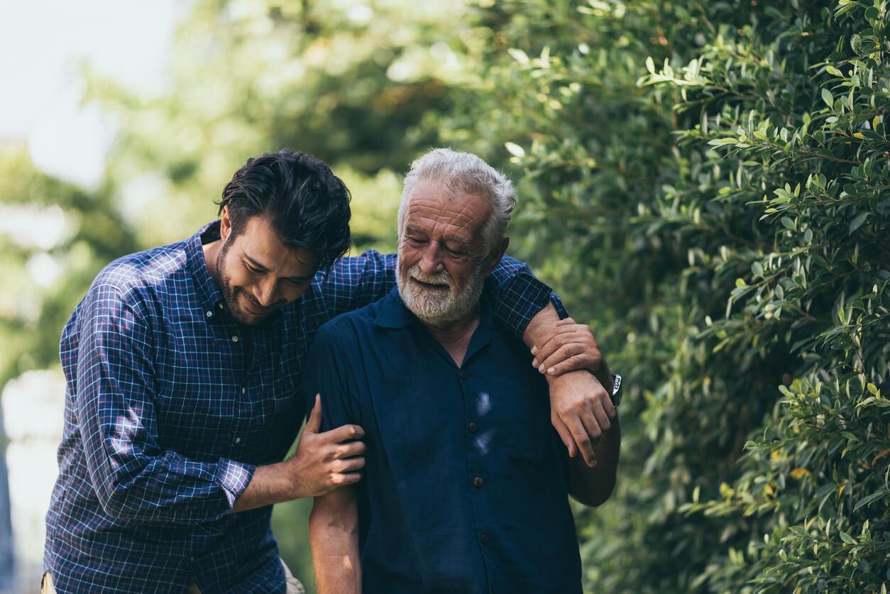 A man helping an elderly person