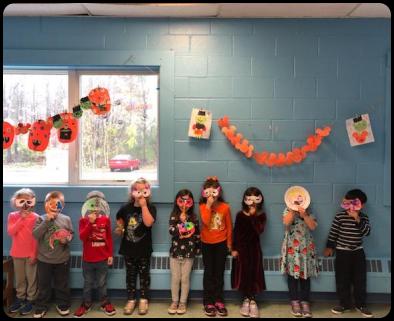 Kids posing with handmade masks