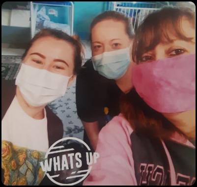 Three teachers wearing masks taking a selfie