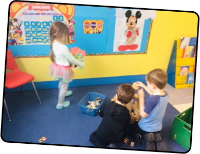Kids playing in a child care room