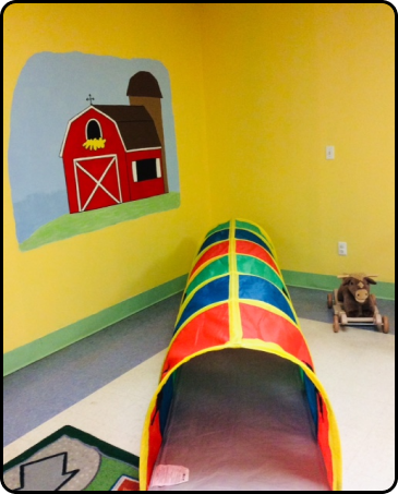 picture of a child care classroom with a drawing of a farm on the wall