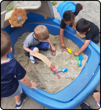 Kids playing in a sand box