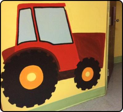 Drawing of a tractor on a child care room wall
