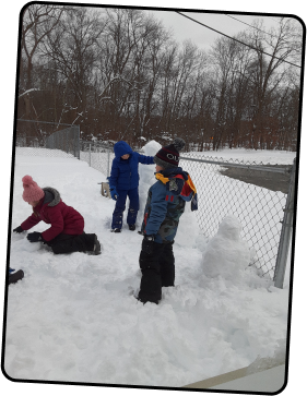 Kids playing out in the snow