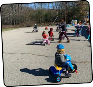 Kids playing and riding toy bikes