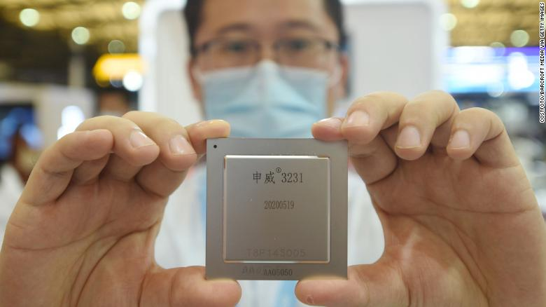 A SMIC employee shows off the latest home-made server chip at the China International Semiconductor Expo 2020. SMIC says its semiconductors are for civilian and commercial use, and that it has no relationship with the Chinese military.