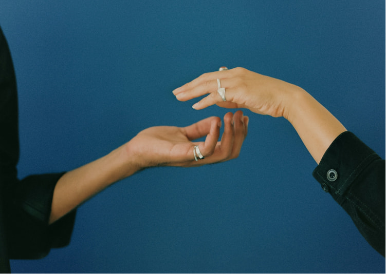 Two hands reach out for each other
