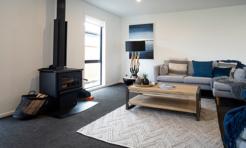 home in jacks point queenstown with dark carpet flooring