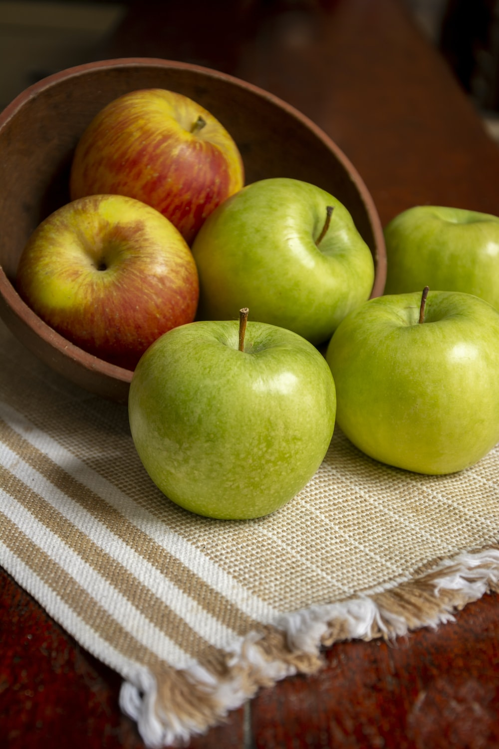 green apple on white table cloth