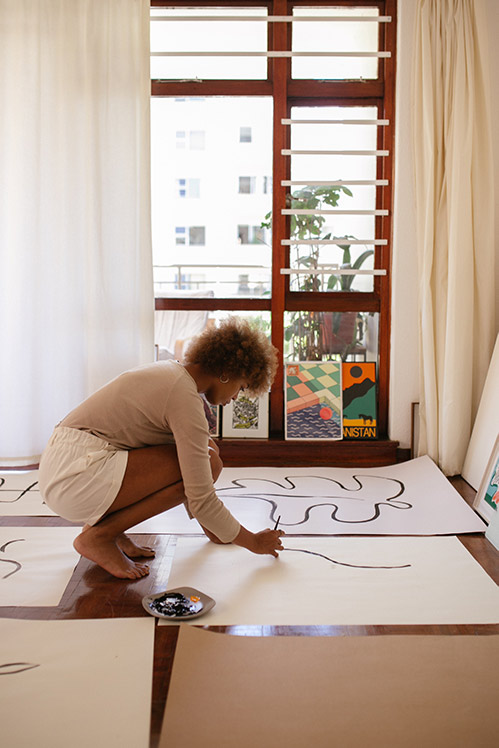Artist creating posters for her online shop