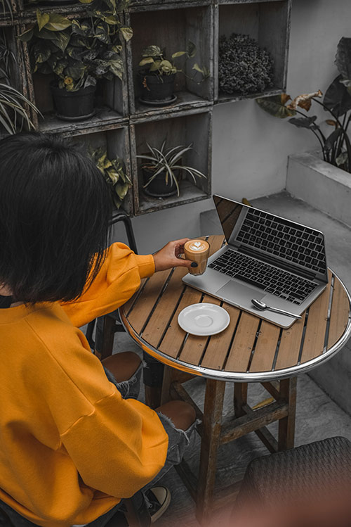 Woman enjoying a coffee while creating her online shop