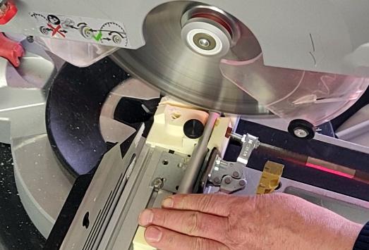 Man cutting aluminium pipes in his online shop