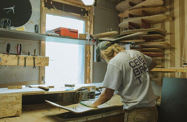 Maker crafting a skateboard for his online shop