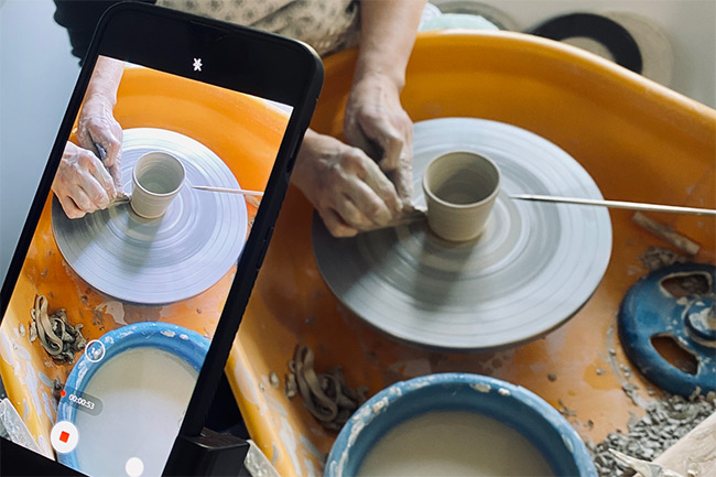 Woman crafting creative ceramics for her e-commerce