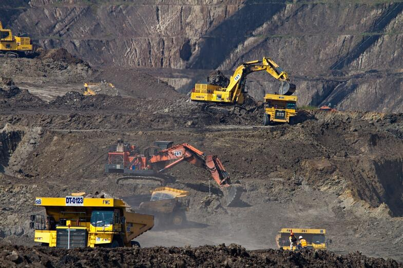 diggers digging in a mine