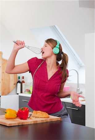 Listening to music and cooking Stock Photos - Page 1 : Masterfile