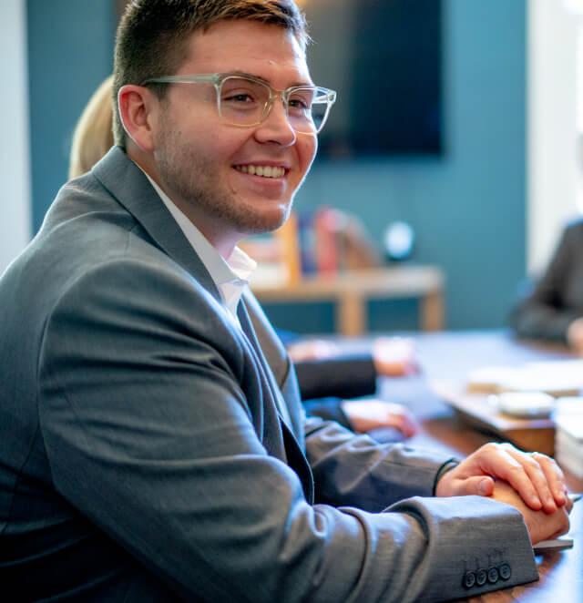 Ryan Rasmussen, Certified Financial Planner, at a firm meeting in Athens at Elwood & Goetz, image