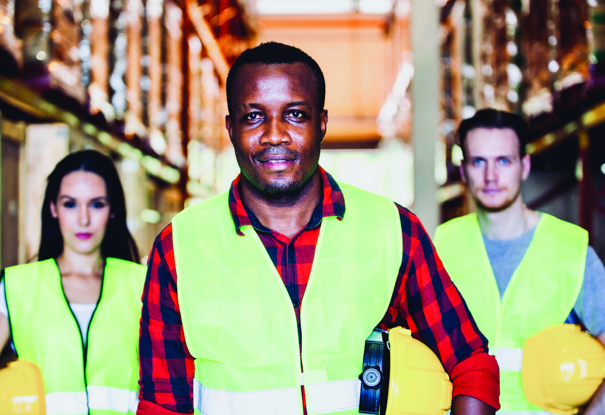 Three construction workers; one woman and two men