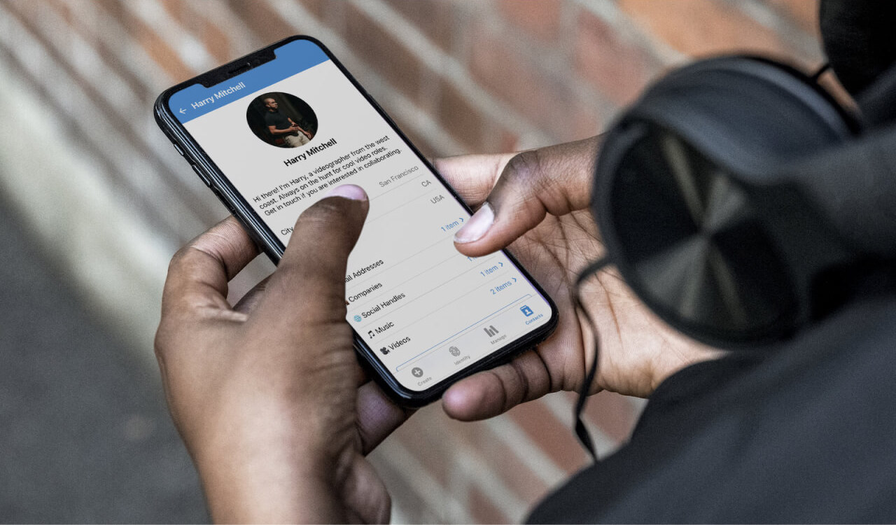 man holding phone with gnito app