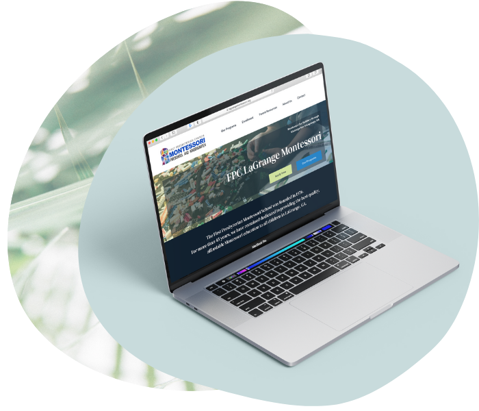 Image of laptop with Montessori website mockup displayed.