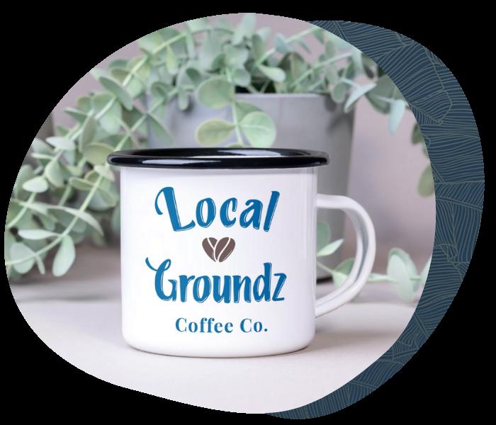 A mockup of the Local Grounds logo on a white coffee mug