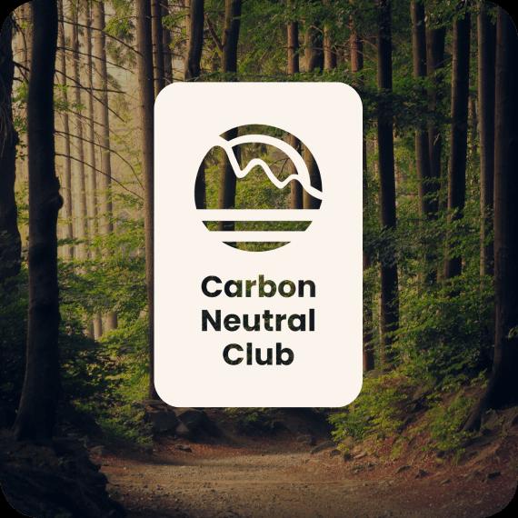 Carbon Neutral Club logo cutout on trees