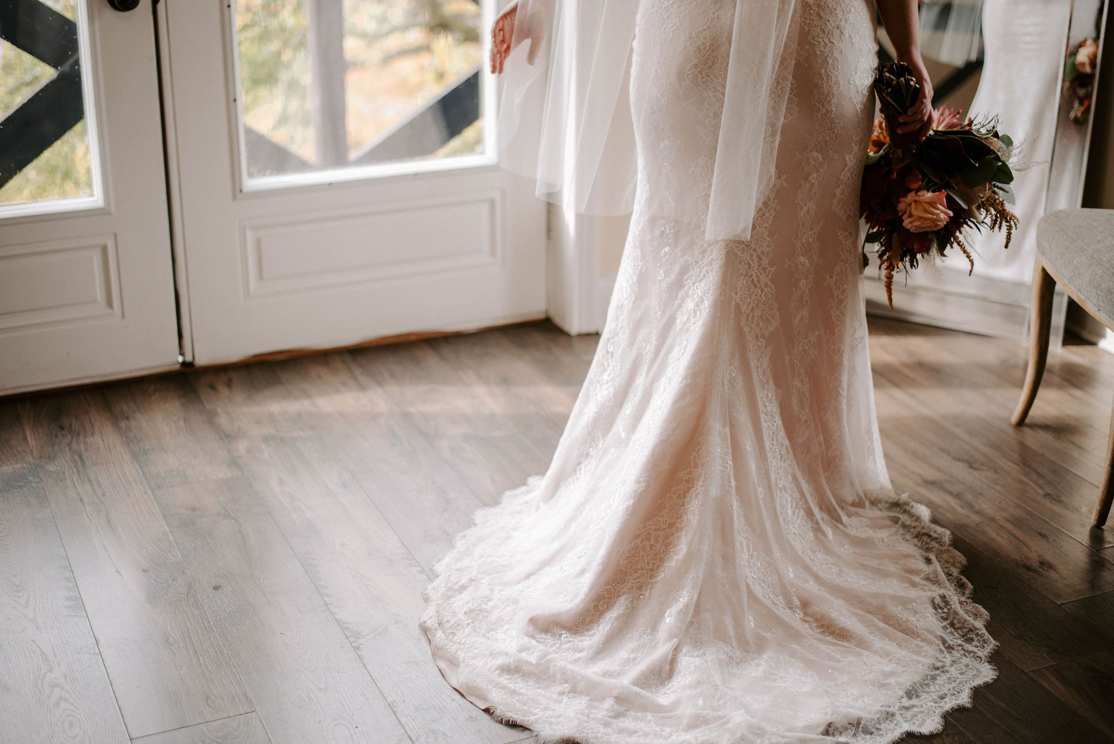 Bride in her gown with bouquet