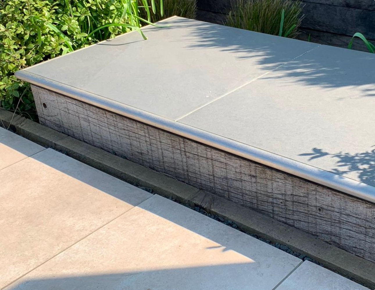 Porcelquick tile trims used on an outdoor seating area