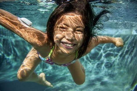 Happy girl swimming with omnipod insulin pump