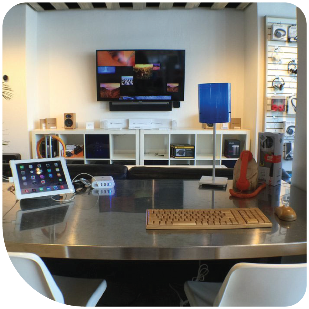 Our Breckenridge retail space. AV installation showcase and iPad sitting on the desk.